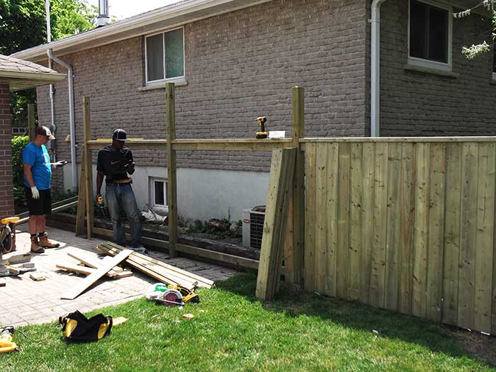 Full privacy premium pressure treated wood fence by