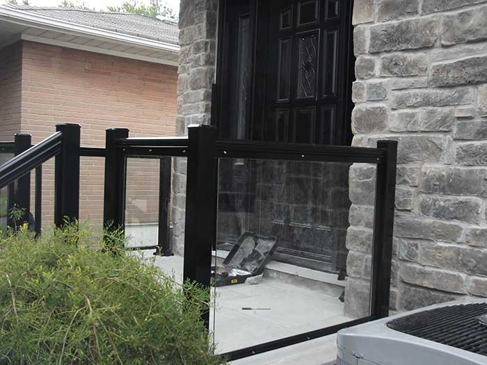 Aluminum-Glass-Railing-During-Installation----New-Market-Ontario by Fence Direct
