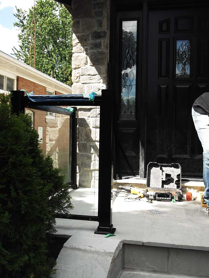 Aluminum-Glass-Railing-During-InstallationProcess-infront-of-a-house-in-New-Market-Ontario by wholesalefence.ca