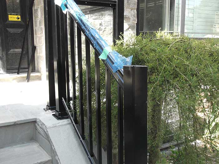 Aluminum-Glass-Railing-During-InstallationProcess-infront-of-a-house-in-New-Market by Fence Direct