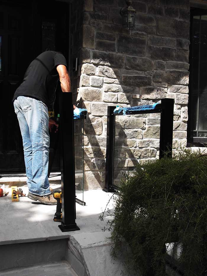 Aluminum-Glass-Railing-During-InstallationProcess-infront-of-the-house-in-New-Market-Ontario by wholesalefence.ca