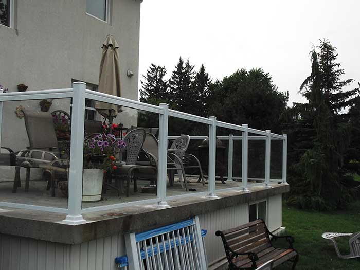 Aluminum-Glass-Railing-Installation-around-Backyard-Deck-in-Markham by wholesalefence.ca