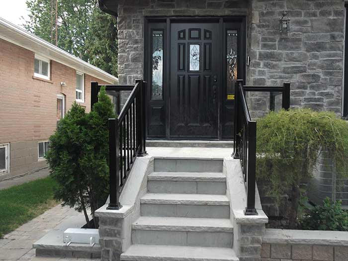Aluminum-Glass-Railing-Installation-infront-of-a-house--in-New-Market by wholesalefence.ca