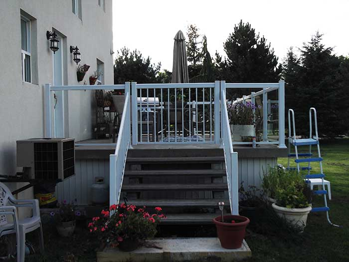 Aluminum-Glass-Railing-Installed-for-Backyard-Deck-in-Markham-Ontario by wholesalefence.ca