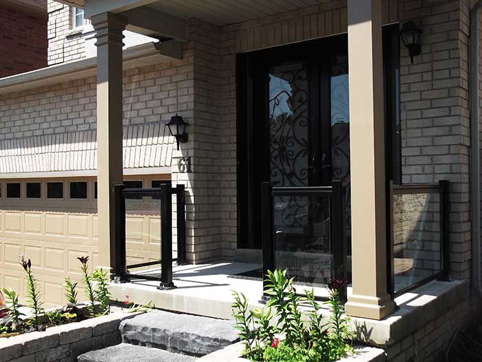 Aluminum-Railing-with-Glass-&-Milan-Design-Doyble-Fiberglass-Doors-with-multi-Point-Locks-and-2-Slim-Side-Lights-installed-in-Richmondhill by wholesalefence.ca