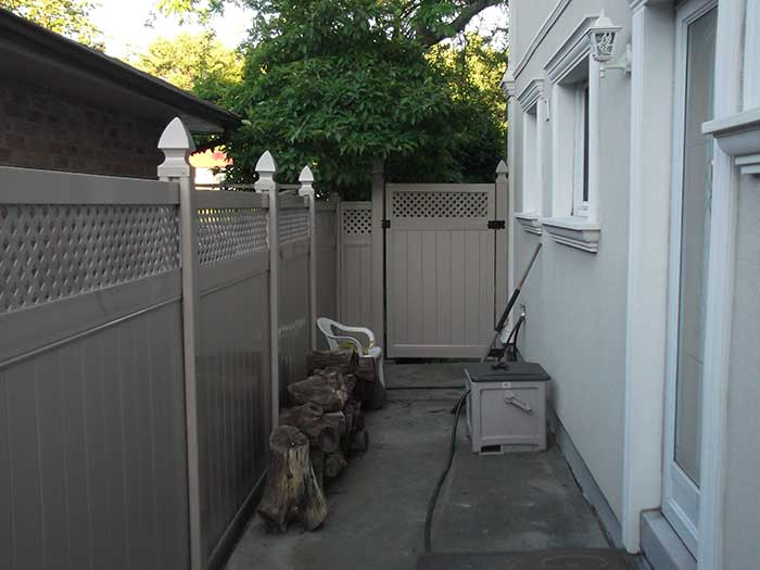Full-Privacy-Vinyl-Fencing-Gate-with-Latice-Installation-in-Richmond-Hill by Fence Direct