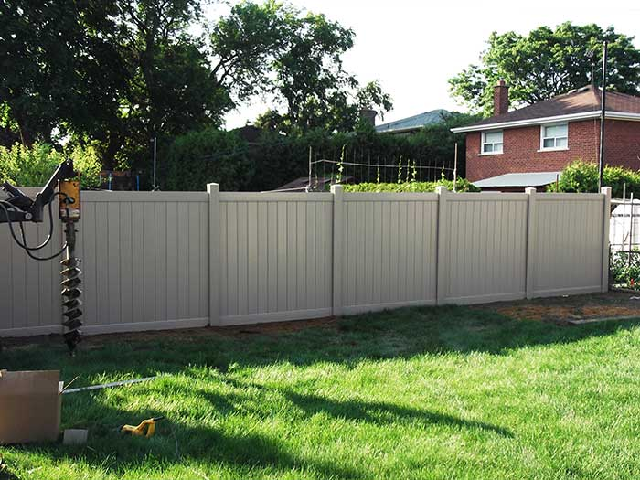 Full-Privacy-Vinyl-Fencing-Installation-in-New-Market-Ontario by Fence Direct
