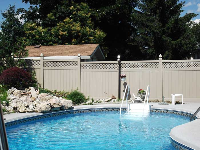 Full-Privacy-Vinyl-Fencing-with-Latice-Installatied-arround-a-private-house-in-Richmond-Hill by wholesalefence.ca
