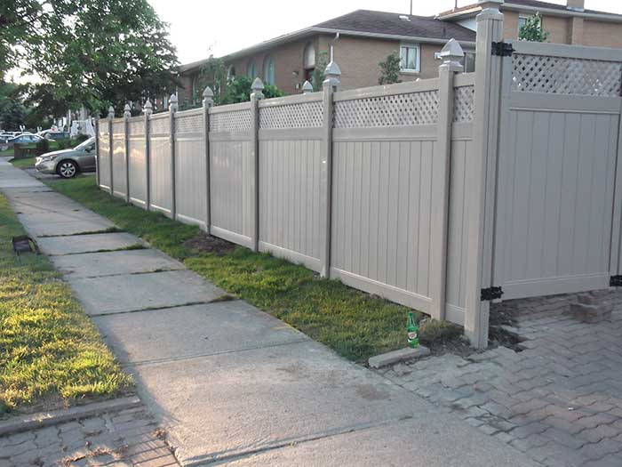 Full-Privacy-Vinyl-Fencing with Latice Installation-in-New-Market,-Street-View by wholesalefence.ca