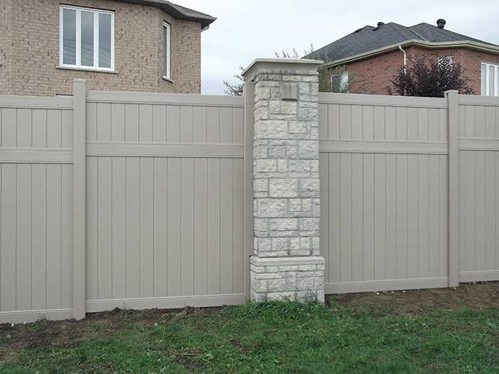 Full-Privacy-Vinyle-Fencing-Installation-in-a-Sub-Division-in-Aurora by Fence Direct