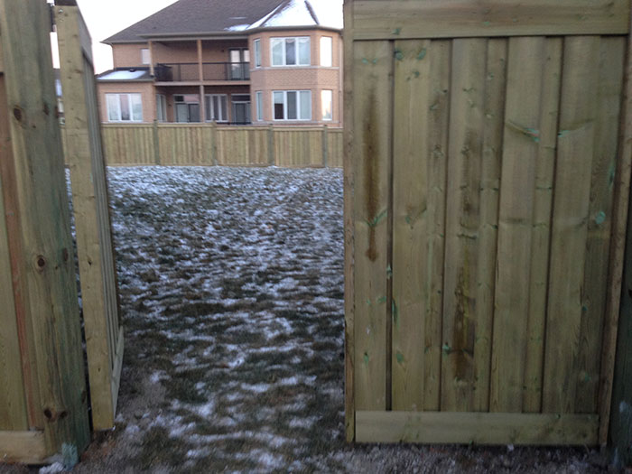 Full Privacy Wood Fencing installation by Wholesalefence.ca