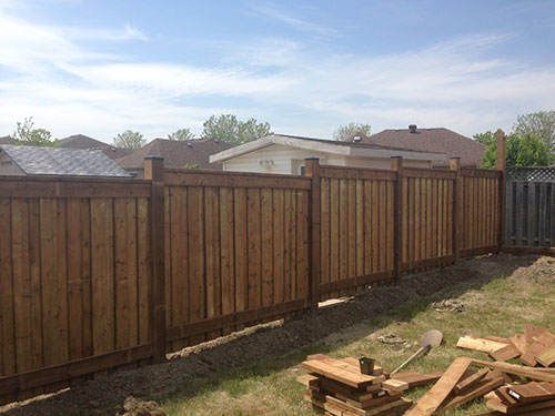 Full privacy wood fence during installation in Richmond Hill by wholesale fence