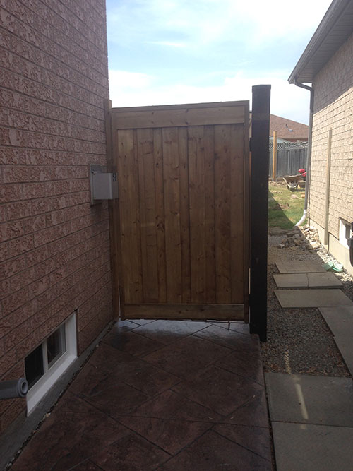 Wood Fence Gate installation by wholsalefence